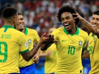 Brazil players celebrate after scoring goal against peru