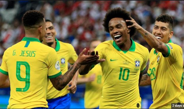 Brazil players celebrate after scoring goal against peru